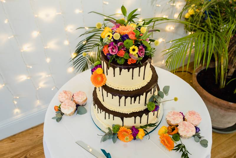 Colourful flowers on wedding cake